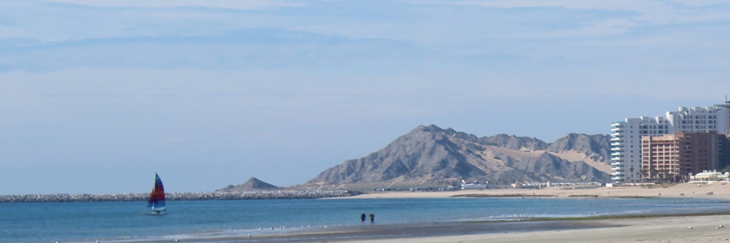 Sailboat, cruise pier, and mountain off Sandy Beach in Rocky Point Mexico (Puerto Penasco).